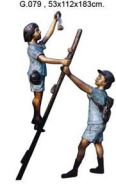 two boys on ladder sculpture