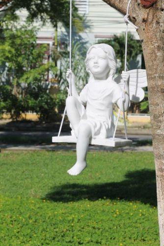 Fairy on a swing garden sculpture